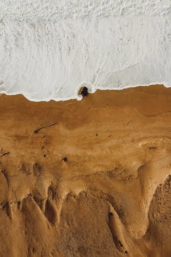 aerial photography of a beach poster collective