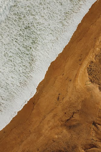 aerial view of a beach with a drone poster collective